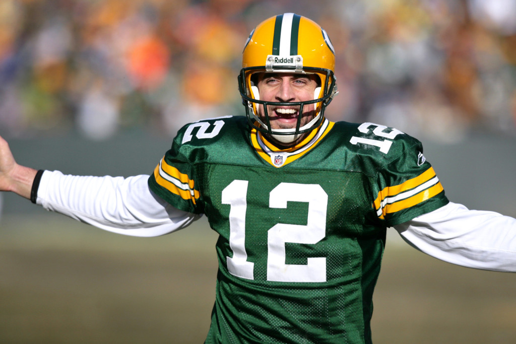 2008-Green Bay Packers' Aaron Rodgers celebrates his 3-yard touchdown pass to Jermichael Finley in the 1st quarter.  The Green Bay Packers hosted the Detroit Lions at Lambeau Field Sunday, December 28, 2008. Steve Apps-State Journal.